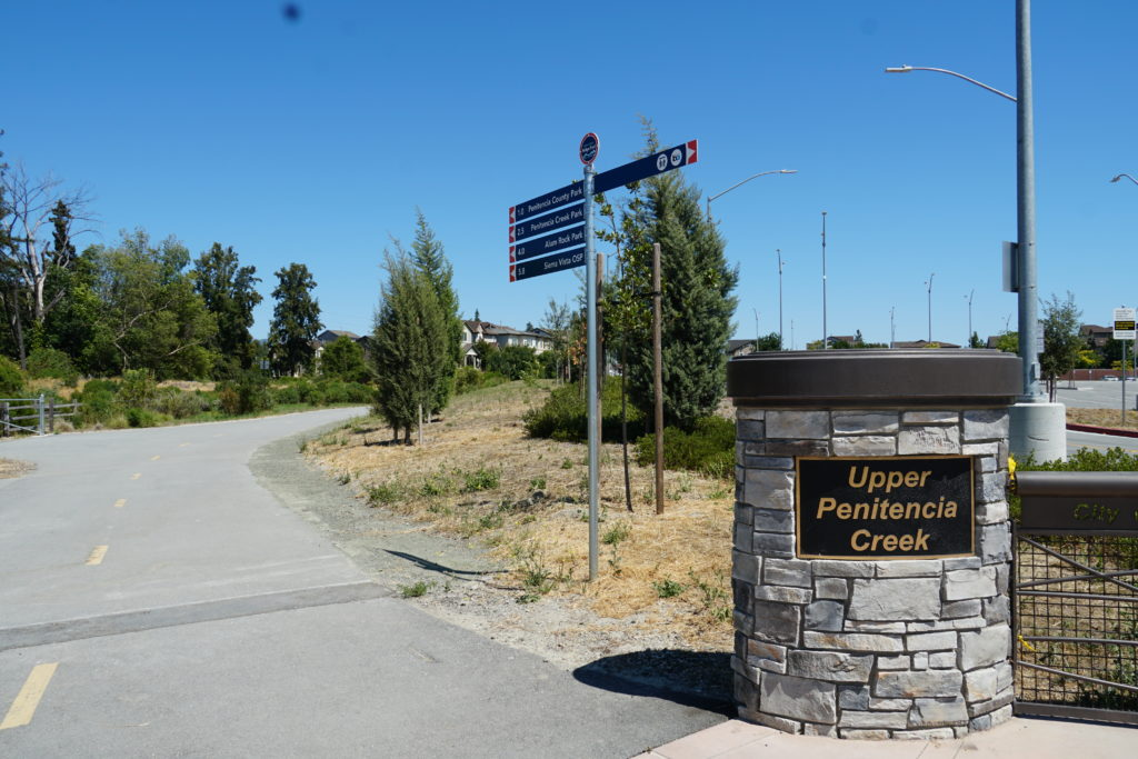 trail entrance with signs