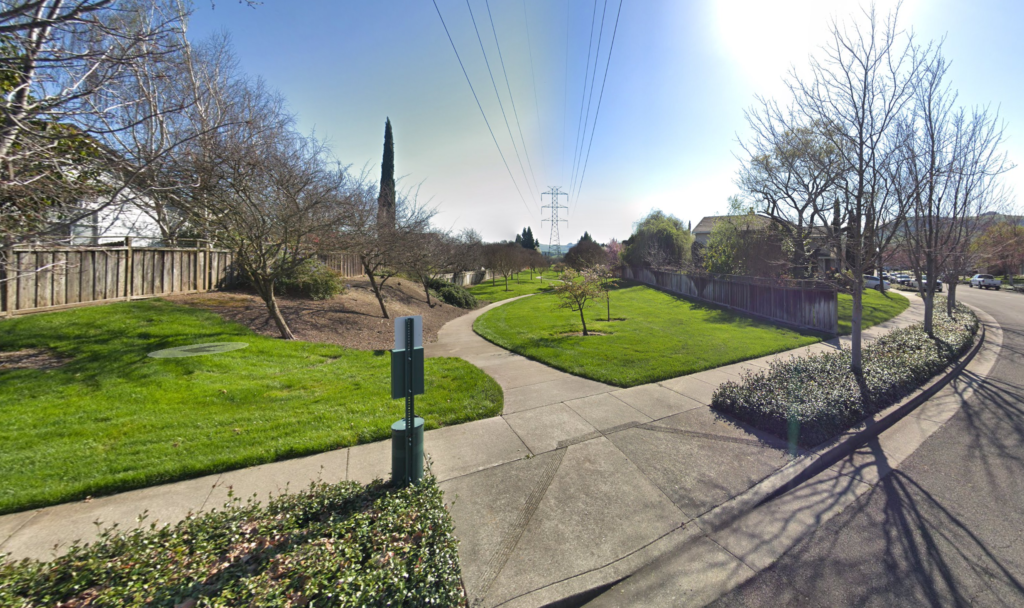 trail entrance traveling through grass in a residential neighborhood